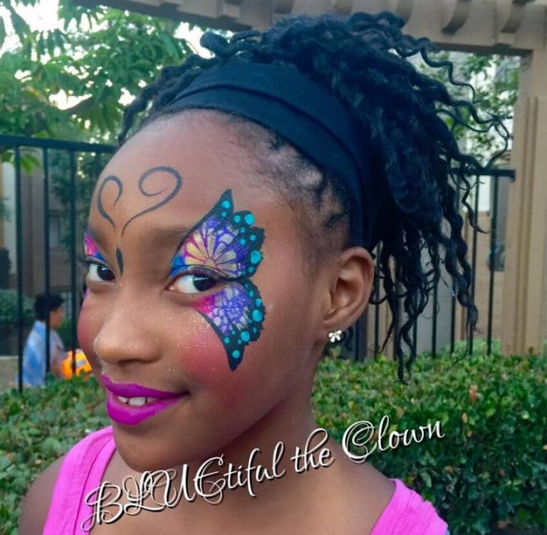 detailed face painting of a butterfly on a teenage girl