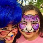 Bluetiful with girl with purple cat face painting
