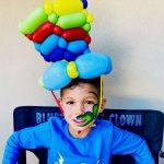 Birthday boy with balloon hat